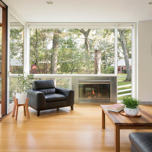 Example Of A Trendy Bamboo Floor And Brown Living Room Design In Boston With White