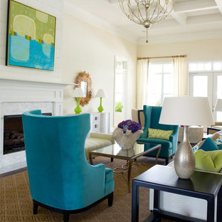 Living room - large contemporary living room idea in Atlanta with beige walls and a standard fireplace