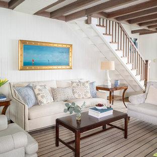 ポートランド(メイン)の大きいビーチスタイルのおしゃれな独立型リビング (白い壁、無垢フローリング、茶色い床、暖炉なし、テレビなし) の写真