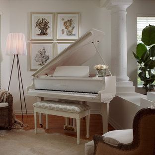 Example of a mid-sized classic enclosed light wood floor living room design in Miami with a music area and white walls