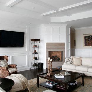 Foto di un soggiorno chic aperto e di medie dimensioni con pareti bianche, TV a parete, parquet scuro, camino classico, cornice del camino in pietra, pavimento marrone e sala formale