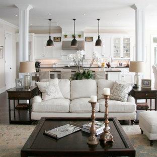 トロントの中サイズのトラディショナルスタイルのおしゃれなLDK (白い壁、濃色無垢フローリング、標準型暖炉、石材の暖炉まわり、壁掛け型テレビ、茶色い床、フォーマル) の写真