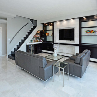 Inspiration for a mid-sized modern open concept marble floor and white floor living room remodel in Cleveland with gray walls, no fireplace and a media wall