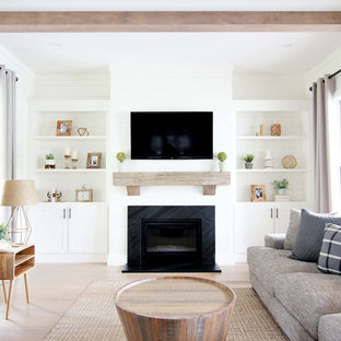 Inspiration for a country living room in Other with white walls, light hardwood floors, a standard fireplace, a wall-mounted tv and beige floor.