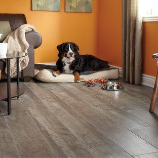 Living room - modern open concept light wood floor living room idea in Toronto with orange walls