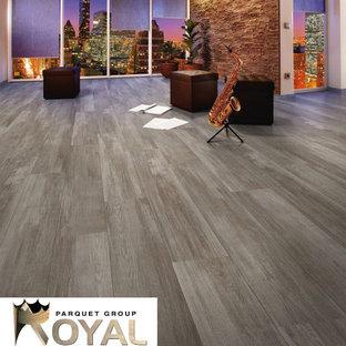 Ispirazione per un soggiorno moderno stile loft con pavimento in laminato