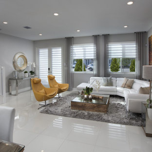 Example of a large trendy open concept porcelain tile and white floor living room design in Miami with gray walls