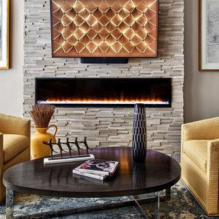 デンバーの中くらいのモダンスタイルのおしゃれなLDK (ライブラリー、グレーの壁、クッションフロア、標準型暖炉、積石の暖炉まわり、壁掛け型テレビ、茶色い床、格子天井) の写真