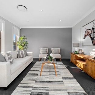 Photo of a contemporary living room in Sydney with grey walls, carpet and grey floor.