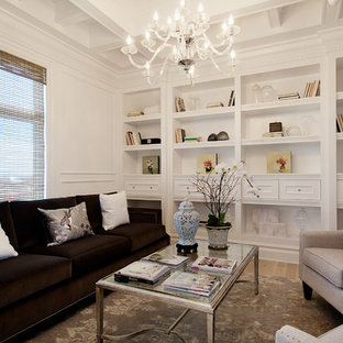 Example of a mid-sized classic formal and enclosed light wood floor and beige floor living room design in Calgary with white walls, no fireplace and no tv