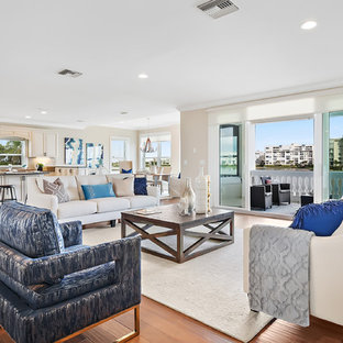 Inspiration for a large nautical enclosed living room in Tampa with beige walls, medium hardwood flooring and a corner fireplace.