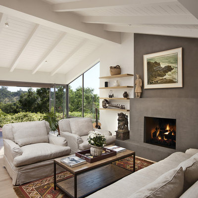 Inspiration for a mid-sized contemporary open concept light wood floor living room remodel in Santa Barbara with a standard fireplace, no tv, a plaster fireplace and white walls