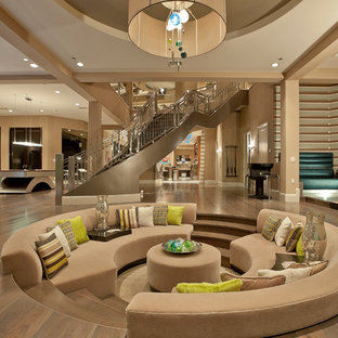 Inspiration for an expansive contemporary open plan living room in Las Vegas with beige walls.