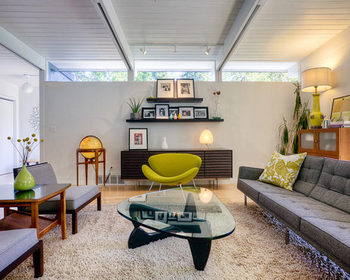 Example Of A 1960s Living Room Design In Seattle With White Walls