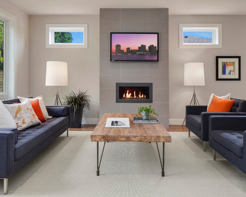 trendy formal living room photo in seattle with gray walls medium tone hardwood floors - Classy Living Room Designs