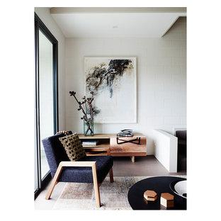 Idee per un piccolo soggiorno moderno stile loft con sala formale, pareti bianche, pavimento in gres porcellanato e parete attrezzata