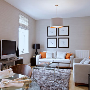 Design ideas for a contemporary living room in Edinburgh with beige walls, light hardwood flooring and a freestanding tv.