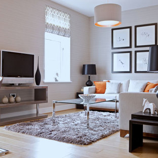 Example Of A Trendy Light Wood Floor Living Room Design In Edinburgh With  Beige Walls And