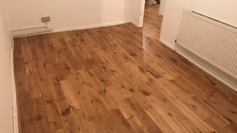Laying solid oak flooring throughout the flat