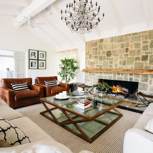 Mid-sized mediterranean open concept living room in Melbourne with a stone fireplace surround, white walls and a standard fireplace.