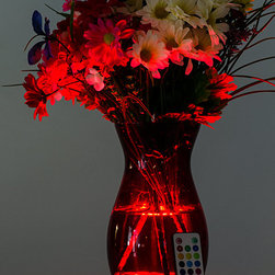 LED Decorative Lighting - Your favorite vase can now double as a lamp! This waterproof floralyte can be changed to a variety of colors with the remote control to suit your fancy at any given time of day or night. Easy to use, bright, and inexpensive, it's perfect for your home!