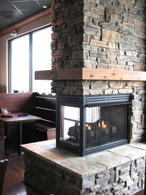 ledge stone fireplace. Example of a classic living room design in Chicago Ledge Stone Fireplaces  Houzz