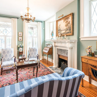 Design ideas for a large traditional formal enclosed living room in Richmond with medium hardwood floors, a standard fireplace, green walls, a stone fireplace surround, no tv and brown floor.