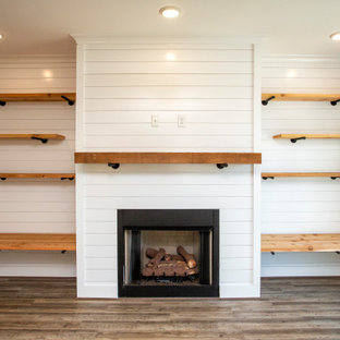 Mid-sized open concept vinyl floor, gray floor and shiplap wall living room photo in Birmingham with gray walls, a standard fireplace, a shiplap fireplace and a wall-mounted tv
