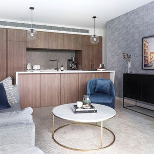 This is an example of a contemporary formal open concept living room in Sydney with white walls, no fireplace, no tv, grey floor and wallpaper.