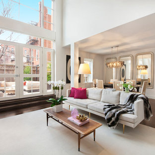 Trendy formal and open concept dark wood floor living room photo in New York with white walls and a standard fireplace