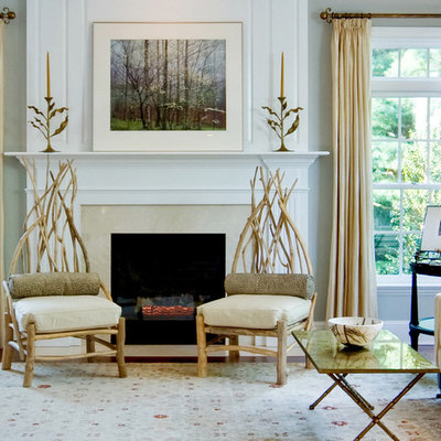 Inspiration for a huge contemporary enclosed medium tone wood floor living room remodel in Philadelphia with gray walls, a standard fireplace, a stone fireplace and no tv