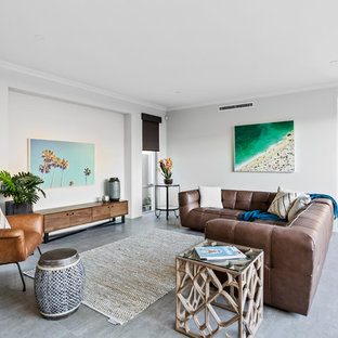 This is an example of a beach style formal open concept living room in Perth with grey walls, no fireplace, no tv and grey floor.