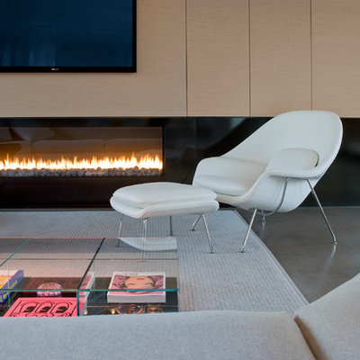 Minimalist open concept concrete floor living room photo in Phoenix with a ribbon fireplace and a wall-mounted tv