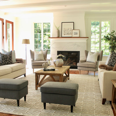 Inspiration for a large transitional open concept medium tone wood floor and brown floor living room remodel in Boston with white walls, a standard fireplace, a stone fireplace and no tv