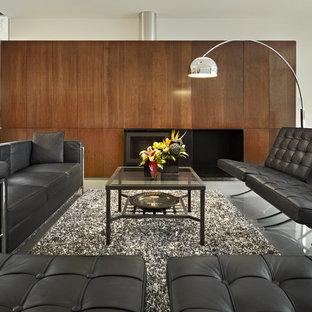 Ispirazione per un soggiorno minimalista con camino classico