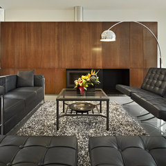 modern living room by thirdstone inc. [^]