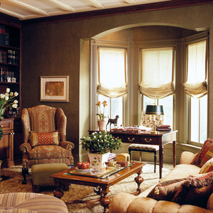 Example of a classic carpeted living room library design in New York with a standard fireplace and brown walls