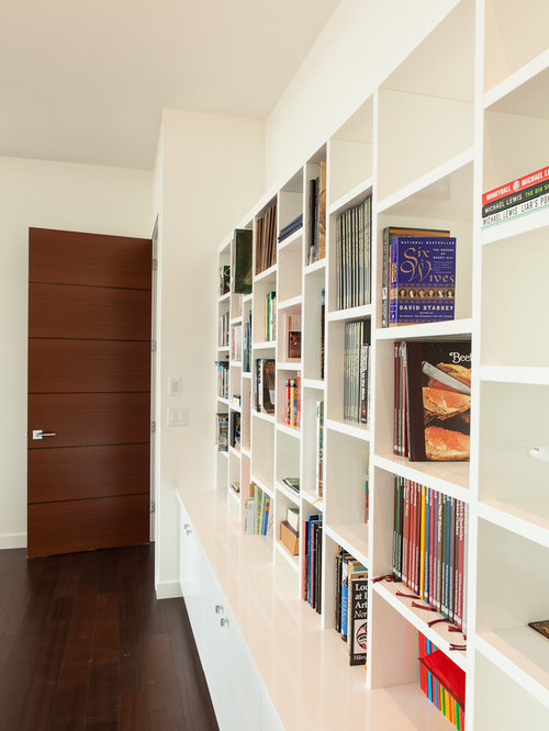 Minimalist living room library photo in Edmonton with white walls