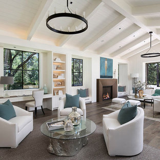 Example of a large country open concept medium tone wood floor and brown floor living room design in San Francisco with white walls, a standard fireplace and a concrete fireplace