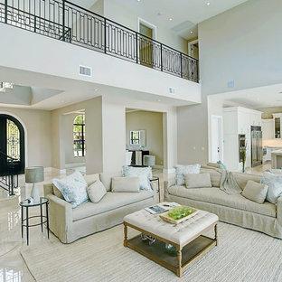 マイアミの大きい地中海スタイルのおしゃれなLDK (フォーマル、テレビなし、ベージュの壁、暖炉なし、ベージュの床、大理石の床) の写真