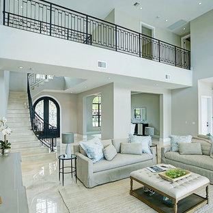 マイアミの広い地中海スタイルのおしゃれなLDK (フォーマル、ベージュの壁、大理石の床、暖炉なし、テレビなし、ベージュの床) の写真