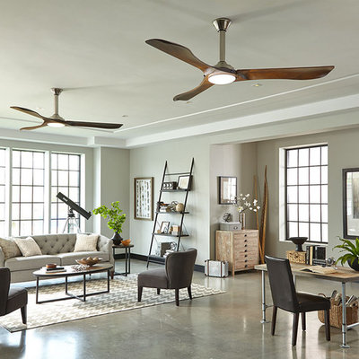 Example of a huge danish open concept concrete floor living room design in New York with gray walls and no fireplace