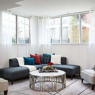 Example of a trendy formal and enclosed black floor living room design in DC Metro with white walls