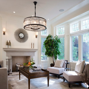 This is an example of a large traditional open concept living room in Chicago with white walls, dark hardwood floors, a standard fireplace and a stone fireplace surround.