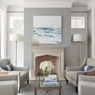 シカゴの中サイズのトラディショナルスタイルのおしゃれなLDK (フォーマル、グレーの壁、濃色無垢フローリング、標準型暖炉、コンクリートの暖炉まわり、テレビなし、茶色い床) の写真