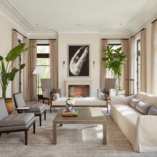 Inredning av ett klassiskt mycket stort separat vardagsrum, med kalkstensgolv, en standard öppen spis, ett finrum, beige väggar och beiget golv