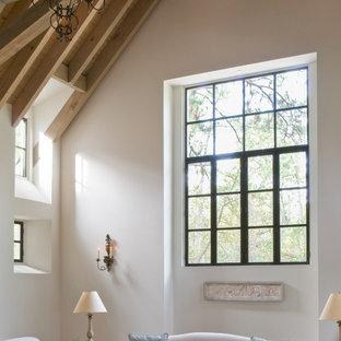ヒューストンの大きいラスティックスタイルのおしゃれな独立型リビング (フォーマル、白い壁、テラコッタタイルの床、標準型暖炉、石材の暖炉まわり、内蔵型テレビ、マルチカラーの床) の写真