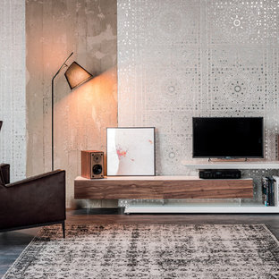 Example of a large minimalist formal and enclosed dark wood floor and gray floor living room design in DC Metro with multicolored walls and a tv stand