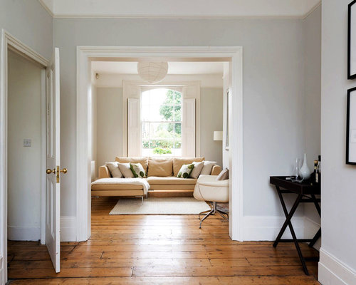 This Is An Example Of A Classic Enclosed Living Room In London With Grey Walls And