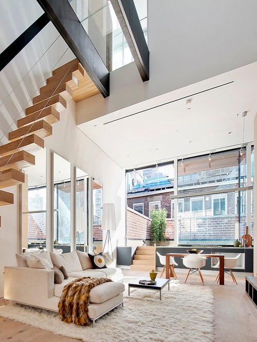 Inspiration For A Contemporary Open Concept Light Wood Floor Living Room Remodel In New York With